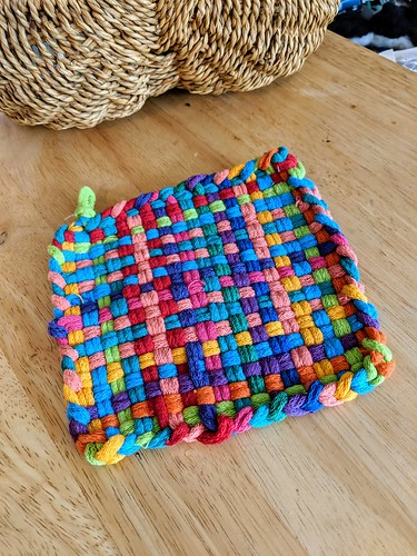 Seven year old's first weaving cotton multi-coloured potholder