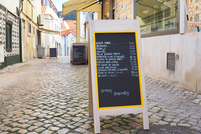 Restaurant menu on cobbled street, Sesimbra