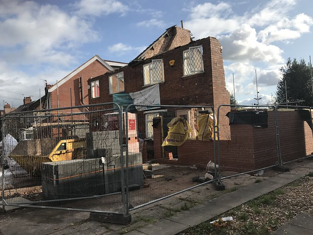 Facadism in progress on 2 unremarkable semi detached houses, Charter Avenue, Coventry