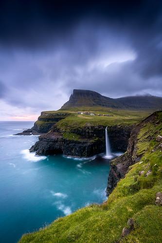 gasaladur mulafossur waterfall vagar faroeislands clouds sunset cloudy ocean travel europe damienborel boblastic