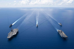 Ships from the Ronald Reagan Carrier Strike Group and Boxer Amphibious Ready Group sail in formation in the South China Sea, Oct. 6. (U.S. Navy/MC2 Erwin Jacob V. Miciano )