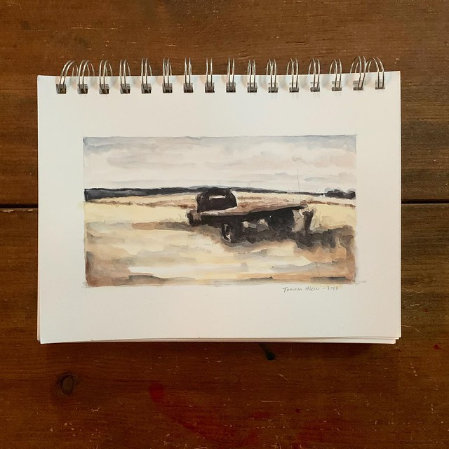 Limited palette watercolor sketch of an old rusted out flatbed truck. Gold Ochre, Venetian Red and Indigo.
