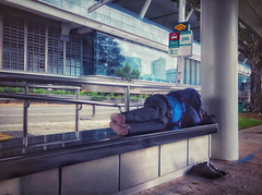 Quite surprised to see a pretty well dressed gentleman sleeping on a taxi stand bench in the middle of the day. Not passing any judgement as we do not know the real story but just hope he finds a more comfortable place or resolves his issue.
