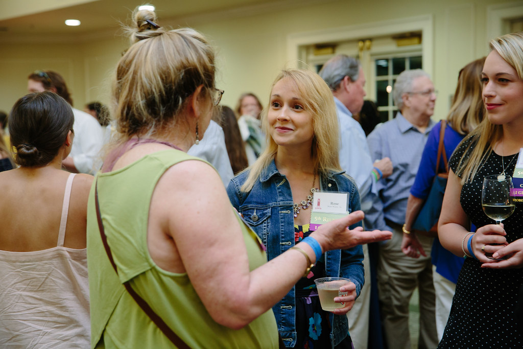 Rose Wynn, '14, center, chats with former classmates.