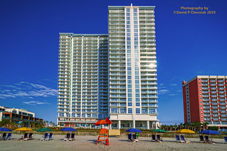 Sunrise Colorful Umbrella's and Beach Chair's Brand New Ocean Enclave by Hilton Grand Vacations owner beach front view (3391) Myrtle Beach, SC 9-24-2019.