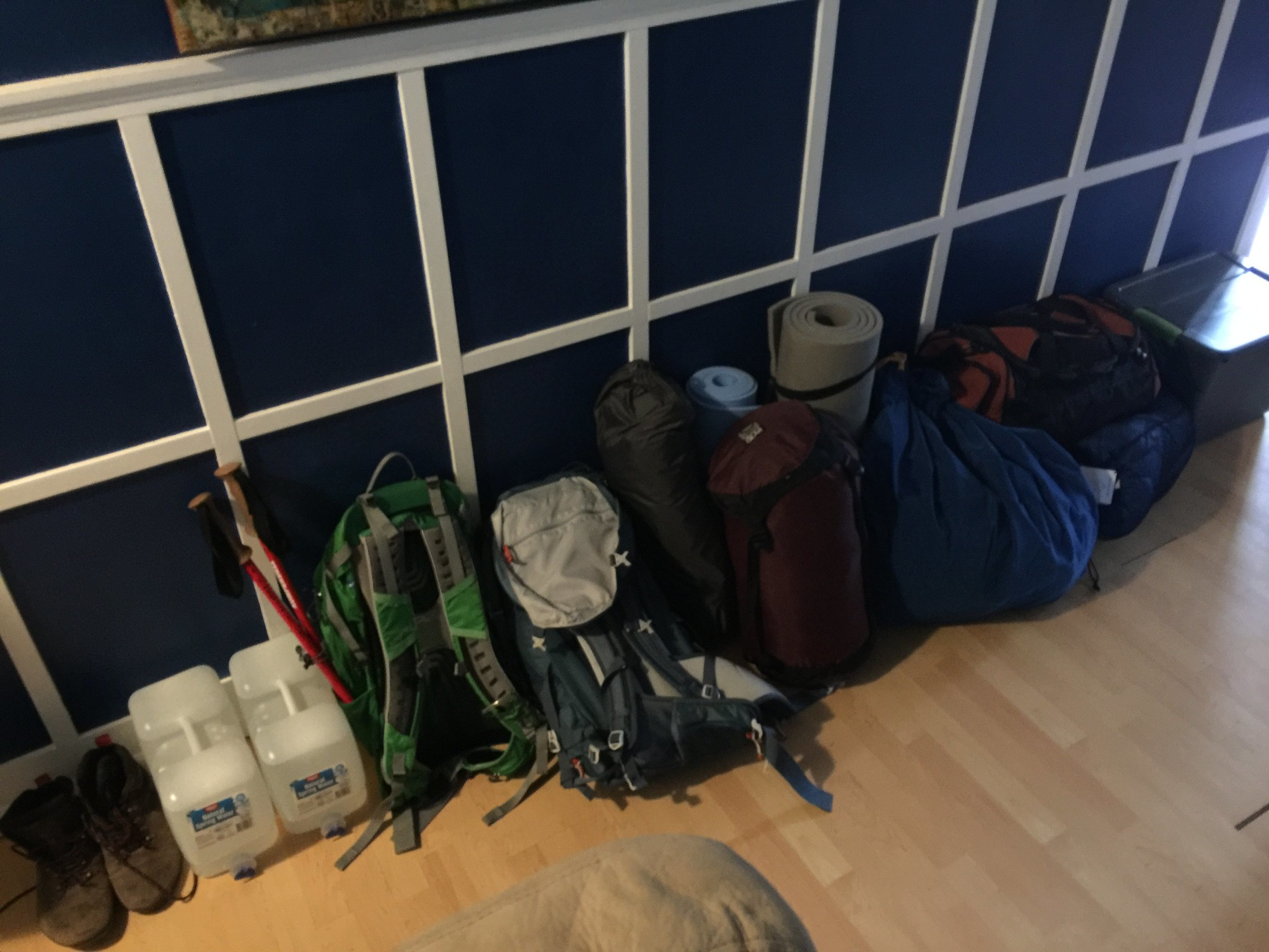 About half of our stuff: Boots, water jugs, several backpacks, and sleeping systems