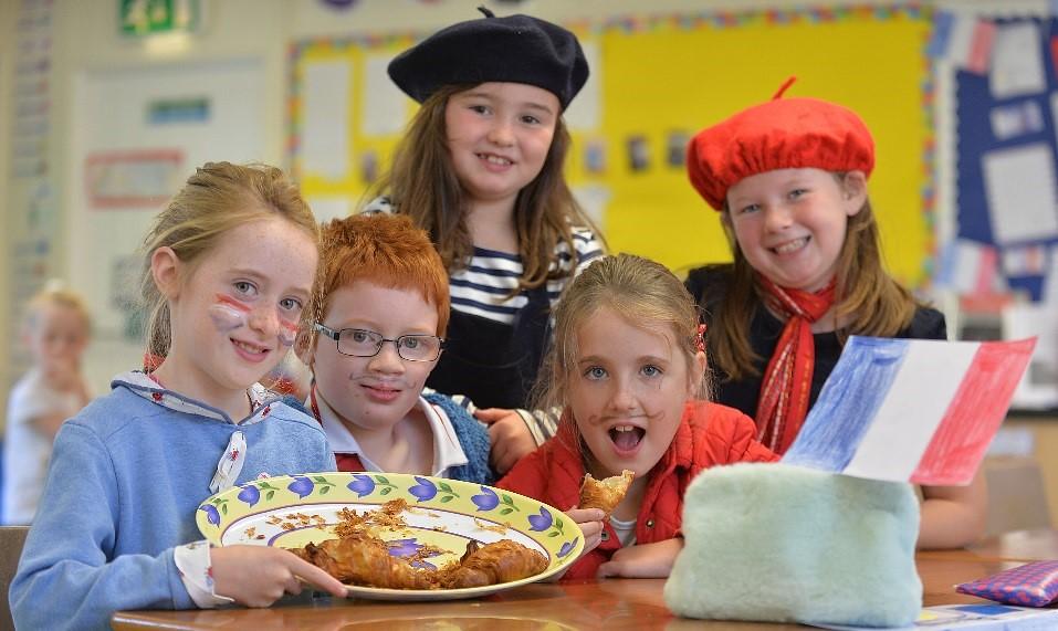 School children in fancy dress for different european countries
