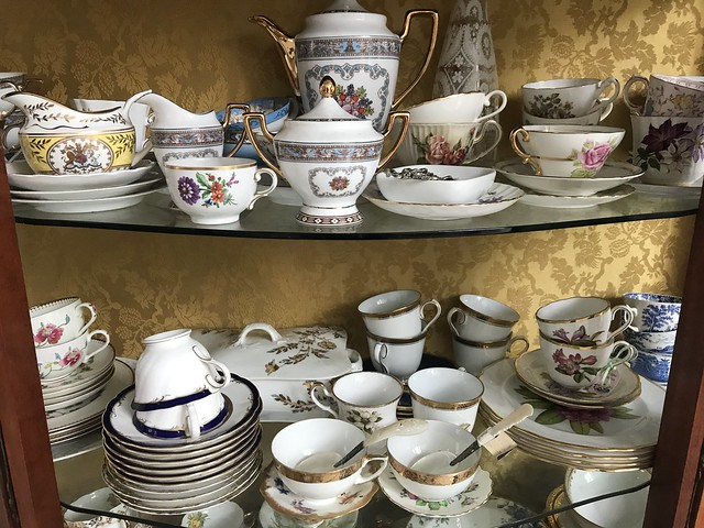 Dusty cups and saucers