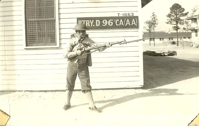 scan0002 Uncle Dom with his M1903 Springfield rifle & bayonet, M1917 WWl helmet circa 1941