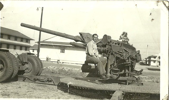 scan0001 Uncle Dom sitting astride his Artillery Piece Ft. Lewis WA circa 1941