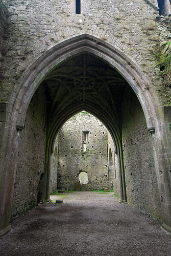 An archway leading to another archway in the ruins of Cashel Hore Abbey in Ireland