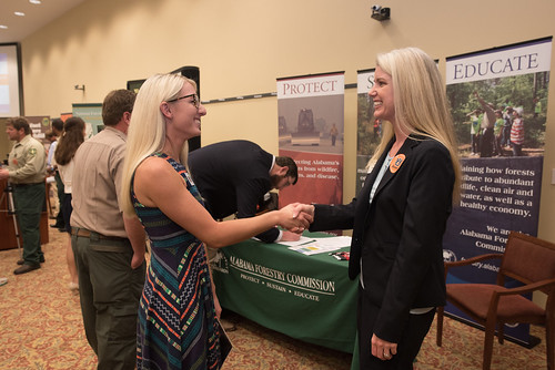 Students talks with a potential employer.