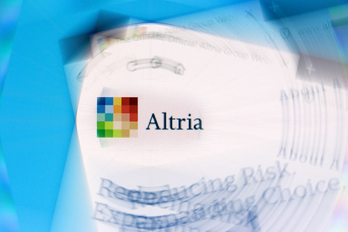 Altria Group logo on company website displayed on computer screen with ripple effect | by Ivan Radic