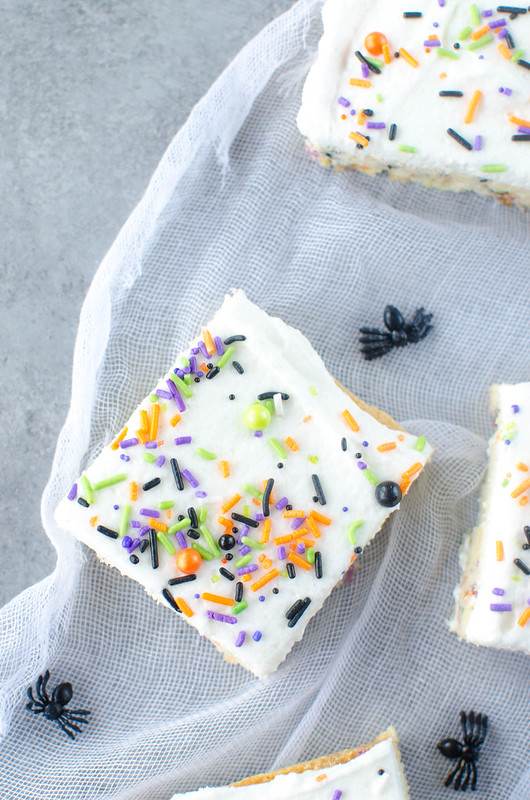 Halloween Sugar Cookie Bars - soft and chewy sugar cookie bars filled with sprinkles and topped with buttercream frosting!
