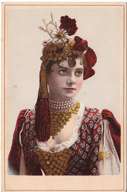 chromo l l otto dordrecht - bust length woman with eleaborate jewellry - pearls and gold looking left