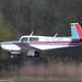 D-ELWK - 1980 build Mooney M.20K Model 231, arriving on Runway 24 at Friedrichshafen during Aero 2017