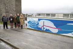 Victoriart team and the Permanent Secretary Leslie Evans viewing the mural