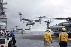 In this file photo, MV-22 Osprey from Marine Medium Tiltrotor Squadron (VMM) 163 (Reinforced) take off from USS Boxer (LHD 4) while operating in the South China Sea in 2019. (U.S. Marine Corps/Lance Cpl. Jared Sabins)