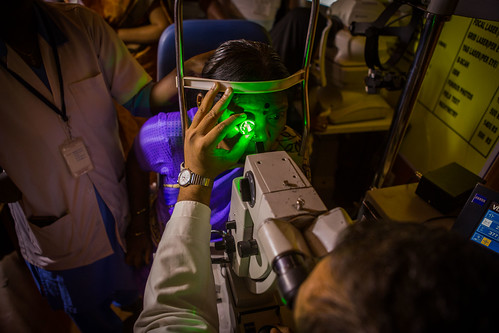 Laser treatment being done inside a mobile eye van for a patient with Diabetic Retinopathy | by IAPB/VISION 2020