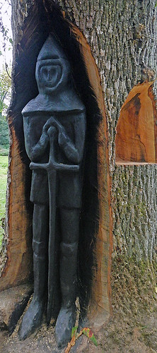 Wood sculpture of a knight lurking in a tree in the park area that surrounds Cahir Castle in Ireland