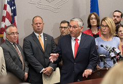 Rep. Fishbein, and his colleagues, look on as Sen. Fasano makes a point during a press conference to bring attention to new and increased taxes on food and groceries with implementation of the state budget on October 1.