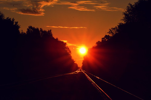 Sun rising over the tracks