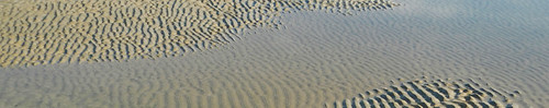 Water Texture: water meets rippling sand at Ngapali Beach in Myanmar