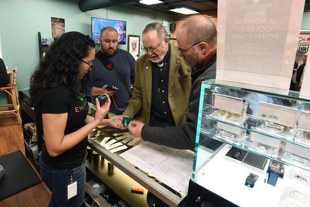 Congressman Don Young watches a tutorial on marijuana grinder usage. October 2019