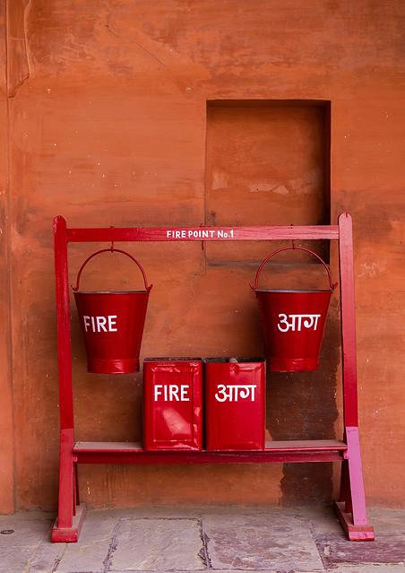Fire buckets hanging by hooks in Junagarh fort, Rajasthan, Bikaner, India