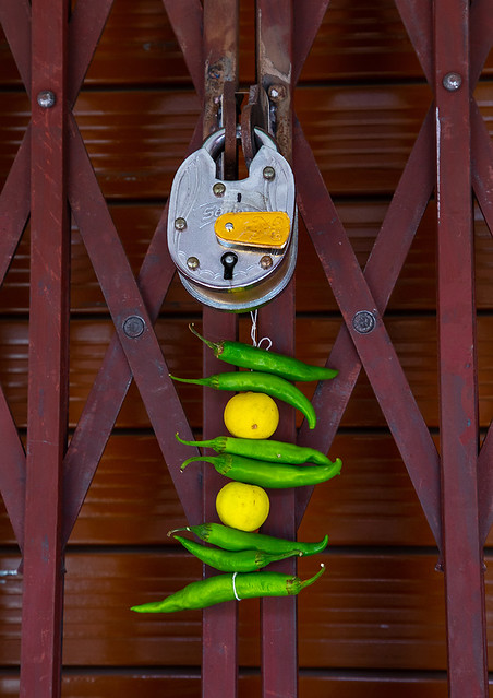 Lemon and green chilli tied on a thread hung outside a door to keep away Alakshmi, Rajasthan, Jaipur, India