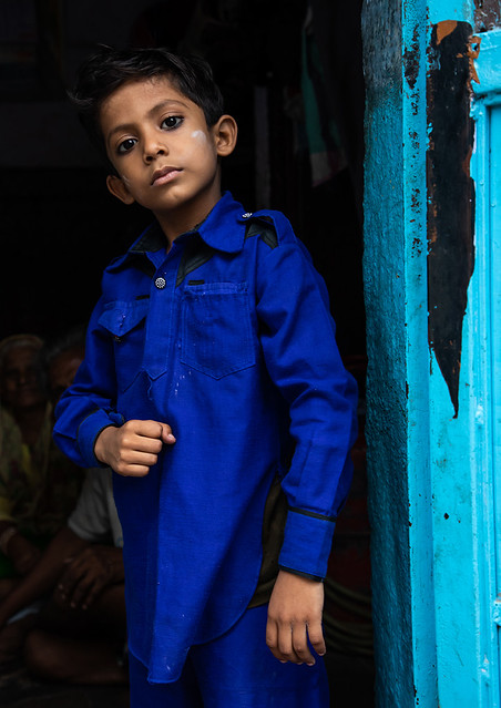 Portrait of a rajasthani boy in blue clothes, Rajasthan, Jodhpur, India