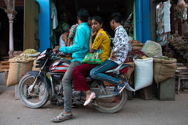 Indian family riding a scooter in the street, Rajasthan, Bikaner, India