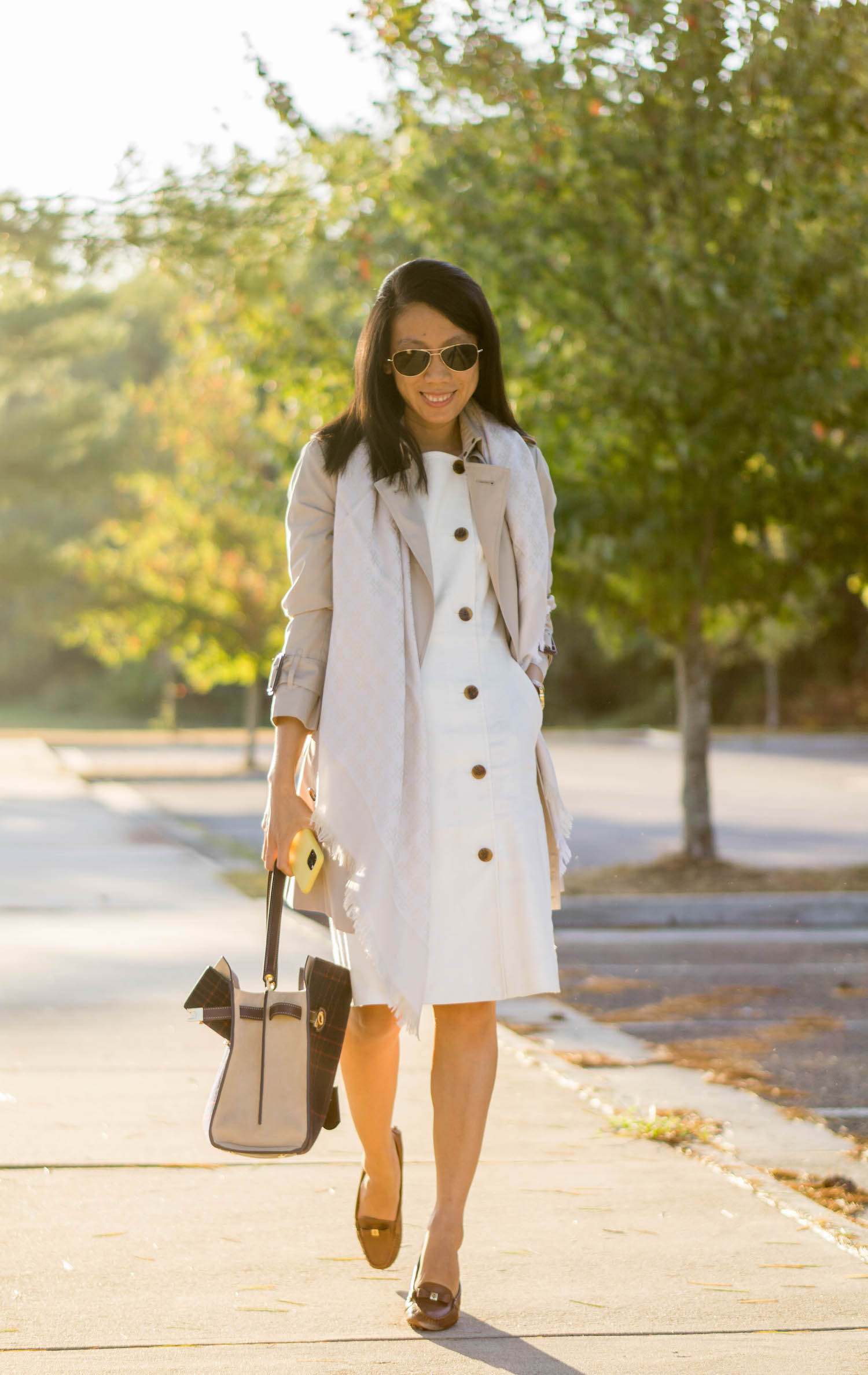 Burberry Marystow trench coat, Tory Burch traveler scarf, Tory Burch Whitney watch, J.Crew double-breasted sleeveless sheath dress, Tory Burch Lee Radziwill double bag in checked splittable wool, Tory Burch Ludlow driver loafers