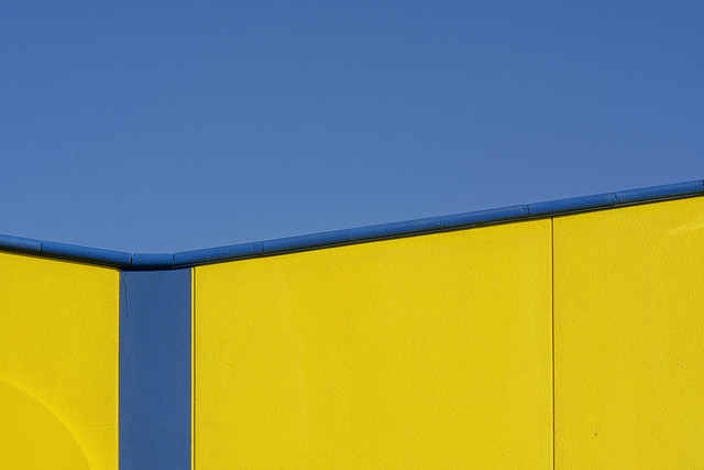 Yellow building with blue stripe