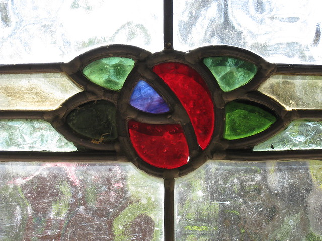Detail of an Art Nouveau Stained Glass Window of a Rose - the Alowyn Gardens, Yarra Valley
