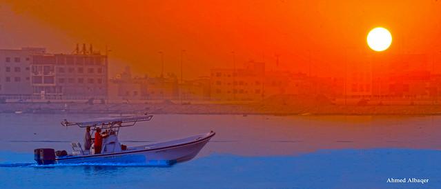 The return of a fishing boat at a dusty sunrise ..عــودة قــارب صيد في صبيحة يوم مغبــر