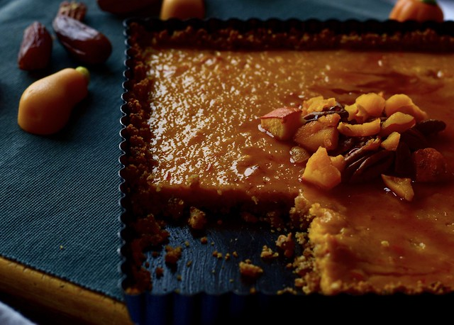 The perfect autumn dessert: Pumpkin bars with a date-pecan crust, prepared with a condensed coconut milk and drizzled a little bit of caramel sauce