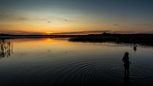 Sun sets behind the Wigry lake, Poland