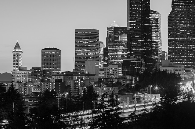 Seattle skyline sunset with city lights and car traffic on I-5
