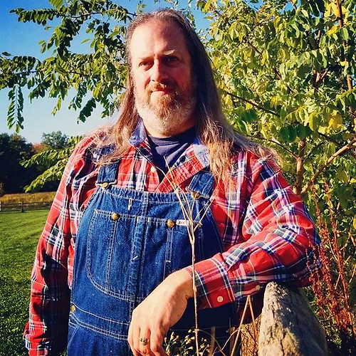 "A possible future author photo. And I'm digging the red-plaid-with-overalls thing, ""Hee Haw"" reminders be damned! #authorphoto #selfie #ootd #overalls #dungarees #biboveralls #vintage #lee #leeoveralls #denim #bluedenim #denimoveralls #overallsarelife #vi"