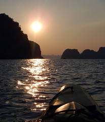 Kayaks in a Halong Bay sunset, Vietnam