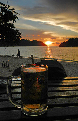 Beer and a sunset at the beach in front of Daddy's in Pangkor, Malaysia