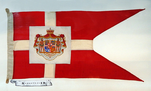 Early version of the Danish flag in the form of a pennant flown from a ship in the Frigate Jylland Museum in Ebeltoft, Denmark