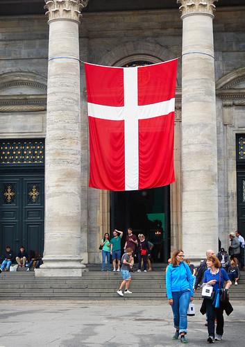 A huge Danish flag hangs between two pillars outside of Frederik's Church in Copenhagen, Denmark
