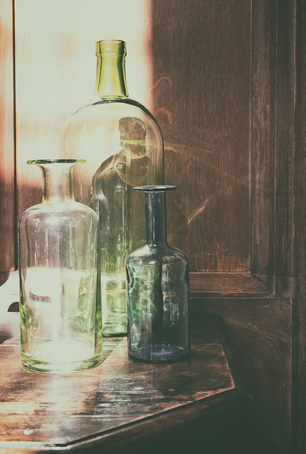 Three Old Fashioned Glass Bottles At The Charterhouse