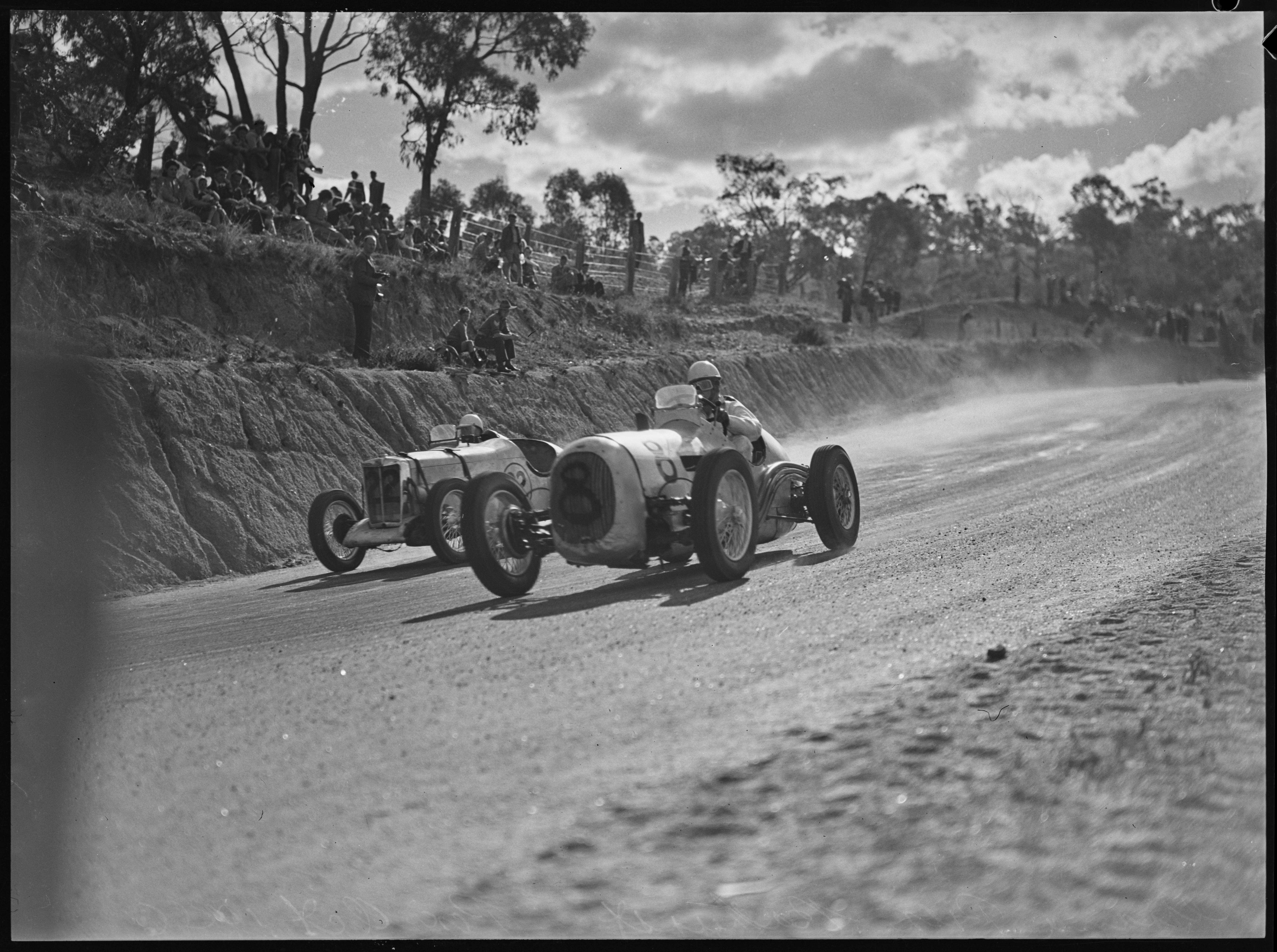 No. 8, Alec Mildren in His Ford V8 Special, cornering next to Jack Nind in his MG TB Special, Grand Prix, Bathurst, October 1946