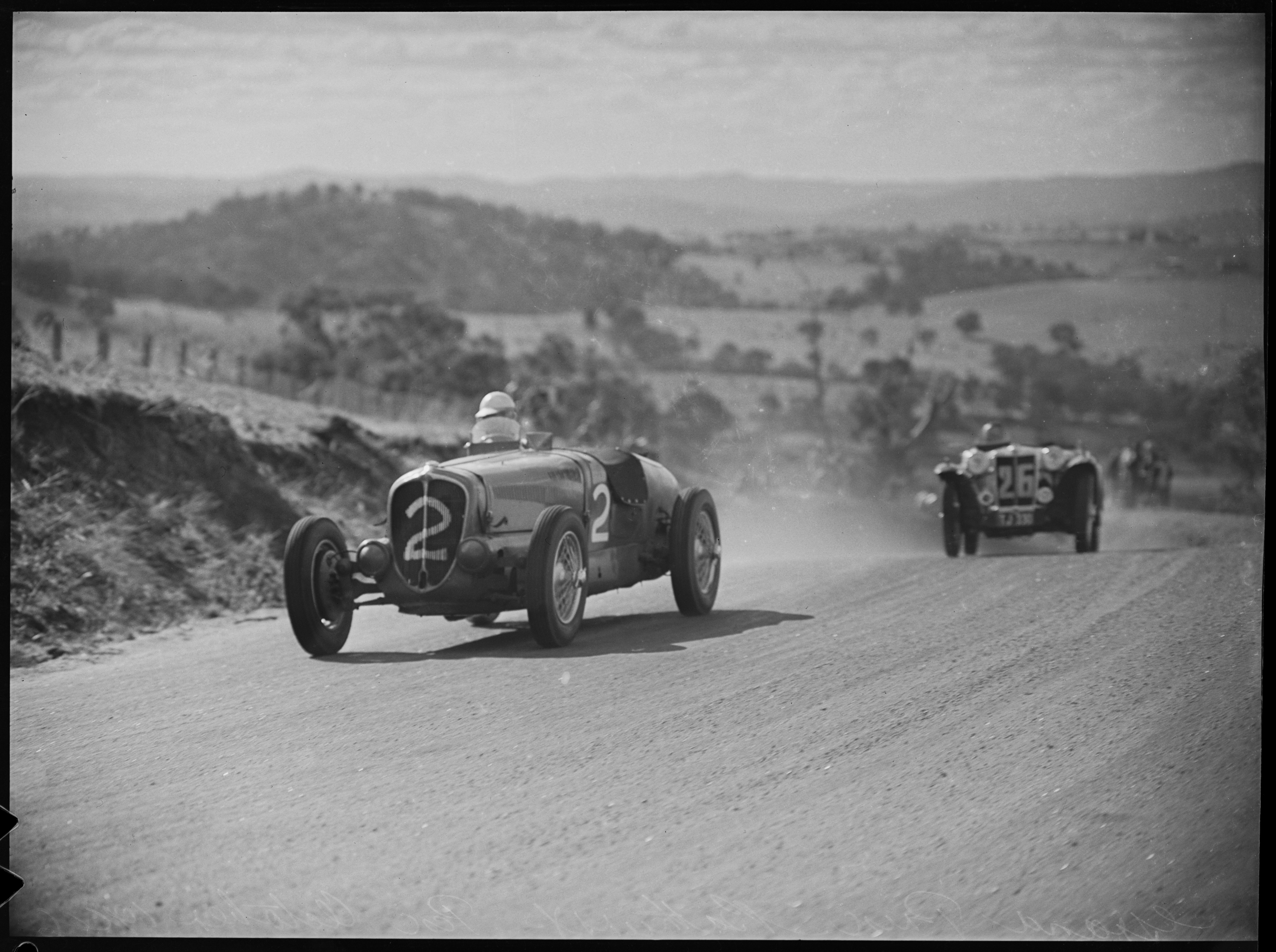 John Crouch in a Delahaye 135 followed by Alby Johnson in a an MG TC, Grand Prix, Bathurst, October 1946