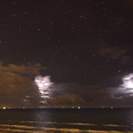 12. September 2014 - 20:51 - Active night thunderstorm cells along the Texas coast. Lights on the horizon are ships waiting to enter Aransas Pass. Nikon D-7000 with Tokina AT-X Pro SD  11-16mm lens.
