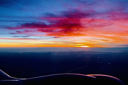 Multi-colored Sunset from Airplane Window