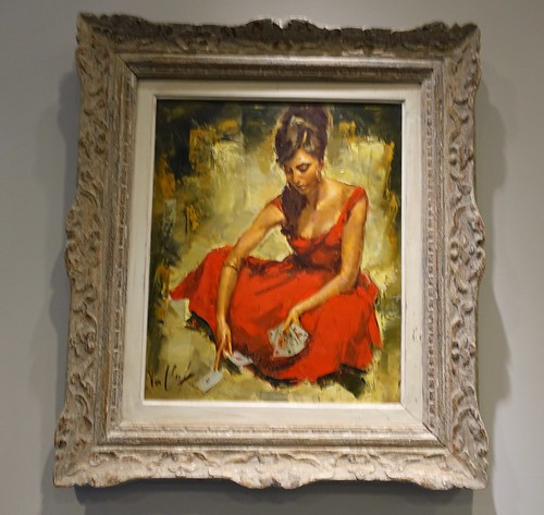 A 20th century Robert Van Cleef oil on canvas painting depicting a fortuneteller in a red dress. From History Comes Alive at Locarno's Belvedere Hotel